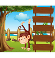 An ape beside the empty wooden signboards vector image vector image