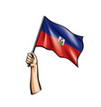 haiti flag and hand on white background vector image vector image