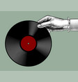 womans hand with a gramophone record vector image vector image