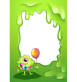 A baby monster with a balloon in front of the vector image vector image