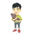 asian happy boy holding a do vector image vector image