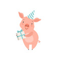 cute little pig in party hat holding gift box vector image