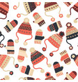 seamless background with hats and mittens vector image vector image