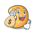 with money bag character cashew nuts heap on vector image