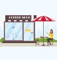 drinking coffee near coffee shop vector image
