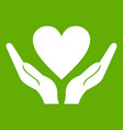 hands holding heart icon green vector image vector image