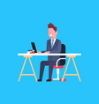 business man sit at office desk working on laptop vector image