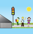 school children at a traffic light vector image