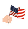 hand holding united states waving flag colorful vector image vector image