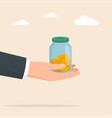 hand with moneybox full coins saving coin in vector image