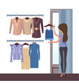 store and woman with clothes vector image