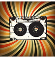 Grunge music background Audio cassette on rays vector image vector image