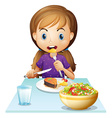 A hungry girl eating lunch