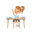 cute girl sitting at the desk and rising her hand vector image vector image