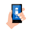 hand holding a smartphone with a microphone icon vector image