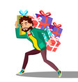 man carries a lot of heavy boxes with gifts vector image vector image