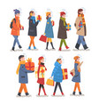 people in winter clothing walking with gift boxes vector image