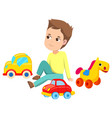 boy with toys sitting on floor cars and horse vector image vector image