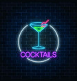 neon cocktail sign in circle frame on dark brick vector image vector image