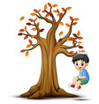 kids playing with autumn tree vector image vector image