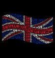 waving british flag pattern of uk text items vector image vector image