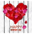 Beautiful heart made from rose petals on wooden vector image