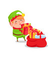 Elf santa s helper put christmas presents red sack vector image