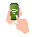 hand holding a smartphone with a wifi icon vector image