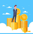 successful businessman standing at bitcoins stack vector image vector image