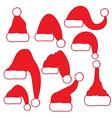Set of red santa hats vector image