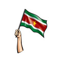 suriname flag and hand on white background vector image vector image