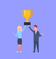 business man and woman holding together golden cup vector image
