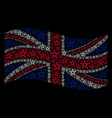 waving uk flag pattern of star pentagram items vector image
