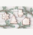 christmas cookies hanging on the tree branches vector image