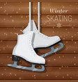 white ice skates on wooden vector image