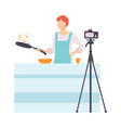 man cooking at kitchen and recording video on vector image vector image