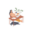 girl sits relaxed at her desk with a laptop vector image