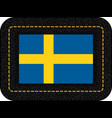 flag of sweden icon on black leather backdrop vector image