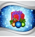 Gift with christmas balls vector image