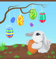 little gray rabbit with easter eggs hanging on vector image