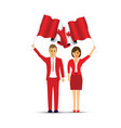 couple waving canadian flags vector image vector image