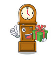 with gift grandfather clock mascot cartoon vector image vector image
