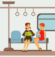 two women sitting in metro train car part of vector image vector image