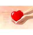 Hands holding a red heart vector image vector image