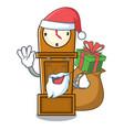 santa with gift grandfather clock mascot cartoon vector image