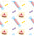 A seamless design with cupcakes and candies vector image