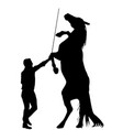black silhouette of man training a horse to vector image vector image