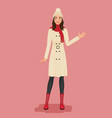 woman in a coat pom pom hat red scarf and boots vector image