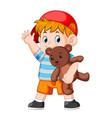 a boy funny play with the teddy bear vector image vector image