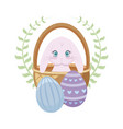 cute rabbit in basket with eggs of easter vector image vector image